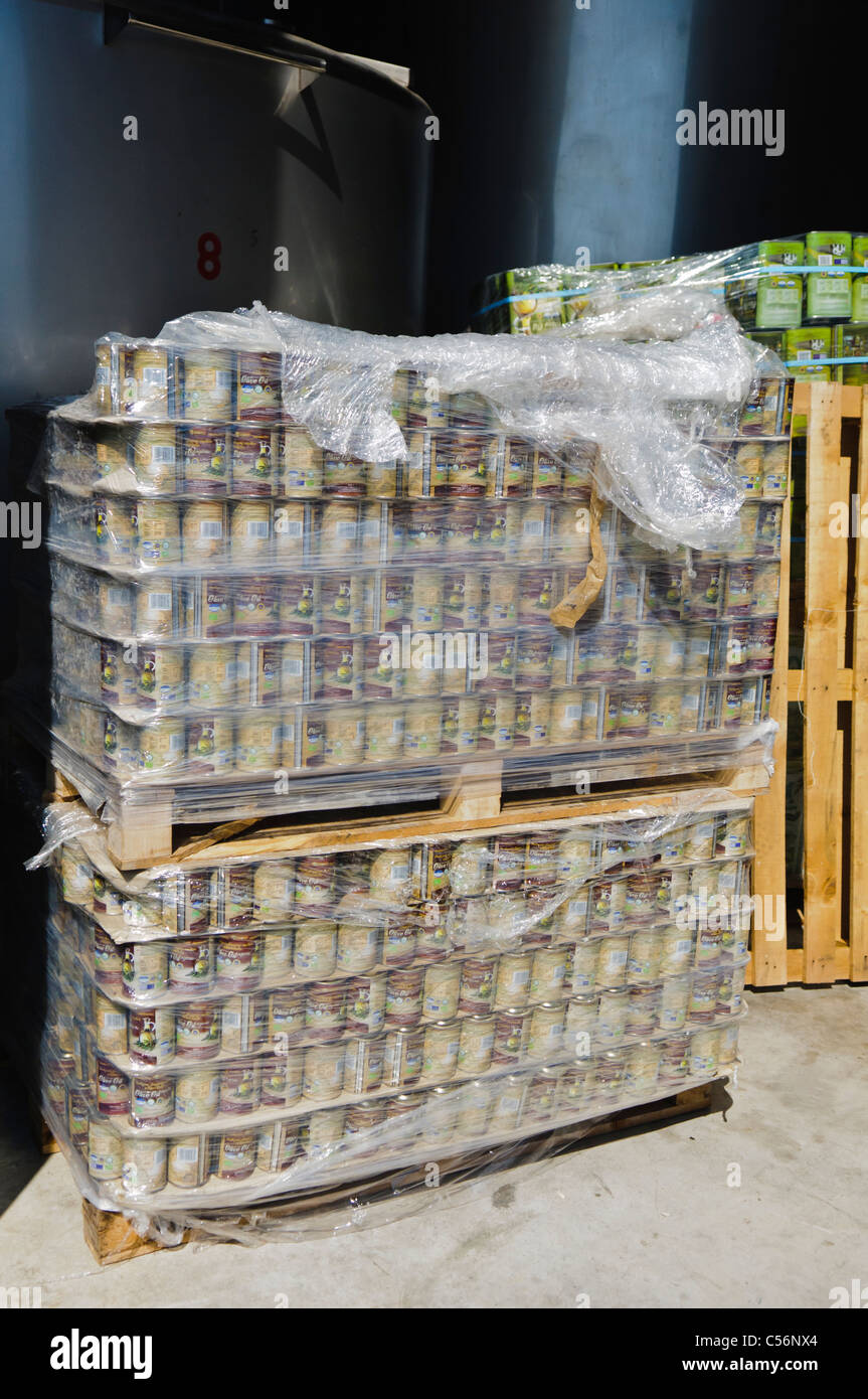 Pallets of tins of Olive Oil in a production factory - Stock Image