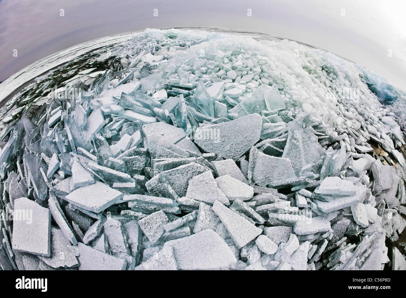 The Netherlands, Oosterleek, Piled up ice on frozen lake called Markermeer. Fisheye lens. - Stock Image