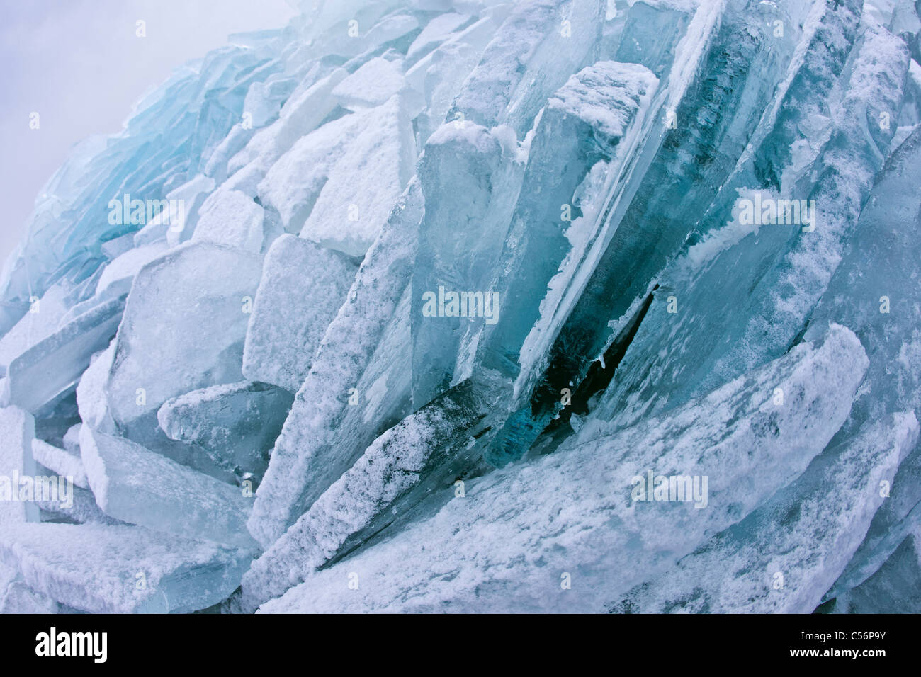 The Netherlands, Oosterleek, Piled up ice on frozen lake called Markermeer. - Stock Image