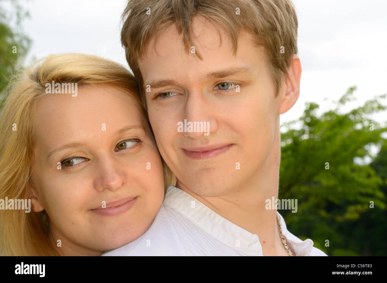 Faces of a happy blond couple fiances of white Eastern European descent - Stock Image