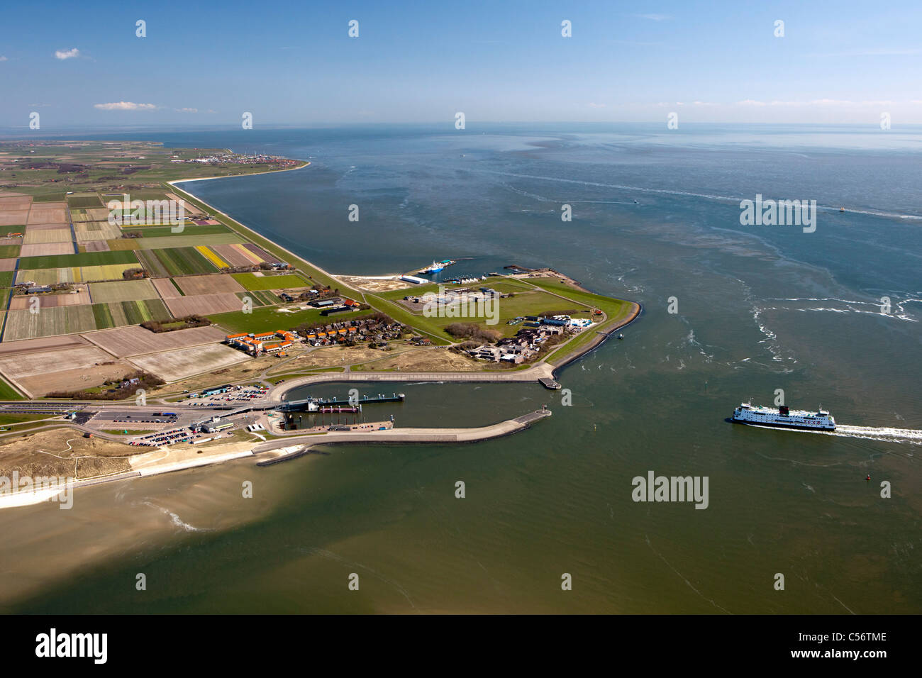 The Netherlands, Harbour and hamlet called Horntje on island called Texel. Aerial. Ferry boat arriving from Den - Stock Image