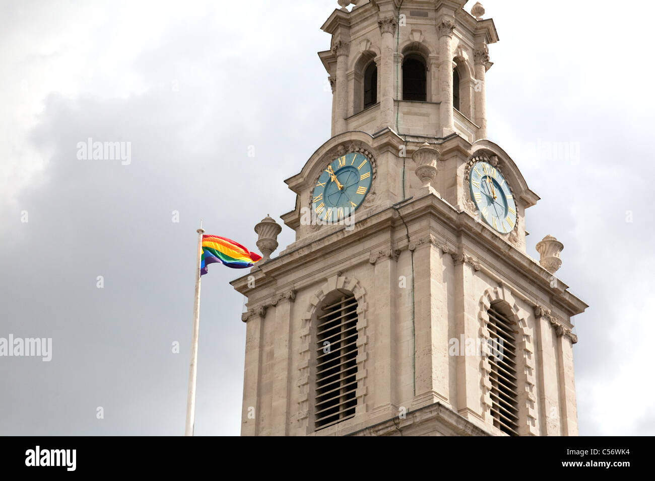 St Martin in the Fields church flying the Pride flag of the LGBT gay movement, Trafalgar Square London UK Stock Photo