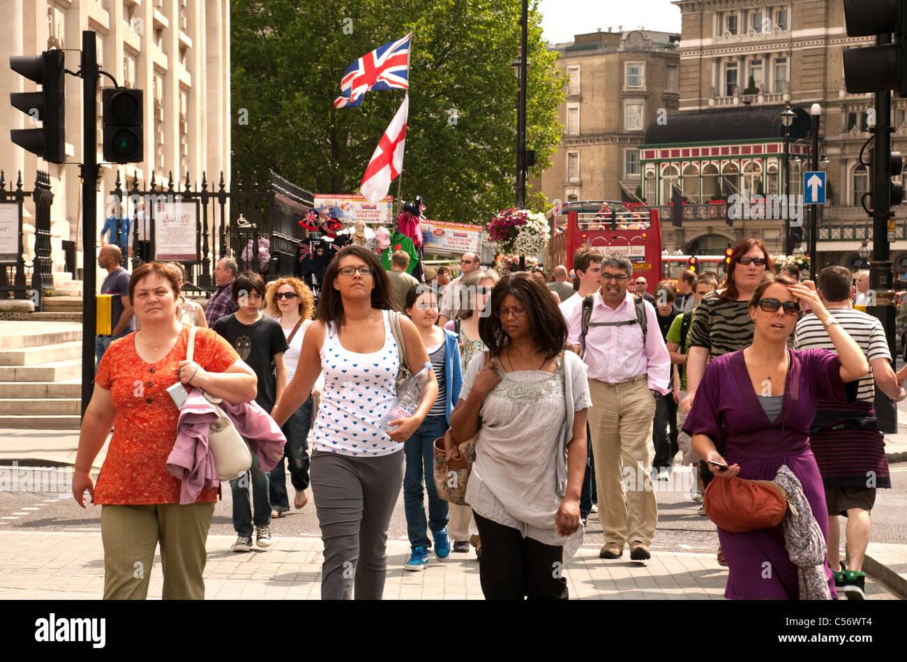 Pedestrians in Duncannon St, Central London, UK - Stock Image