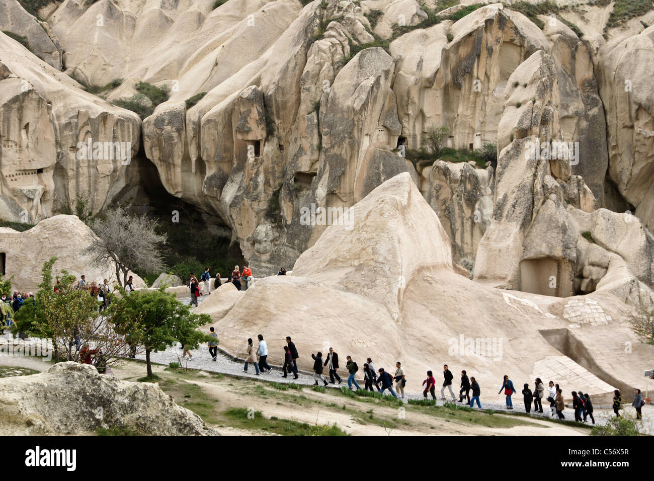 Rock-hewn dwellings and church at Goreme Open-Air Museum, Cappadocia, Turkey - Stock Image