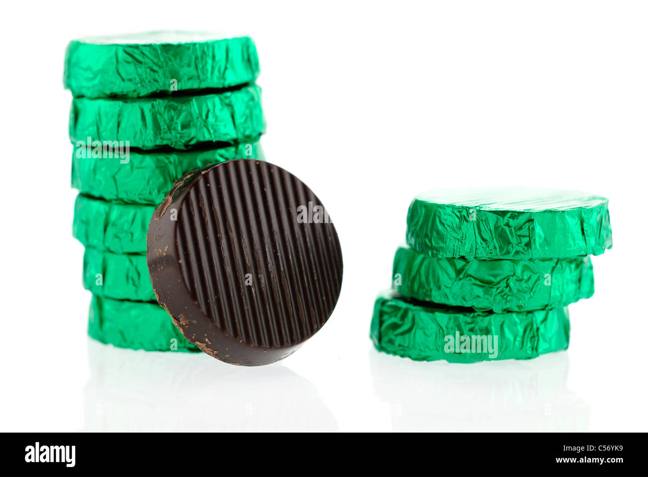 Green silver foil wrapped mint dark chocolates - Stock Image