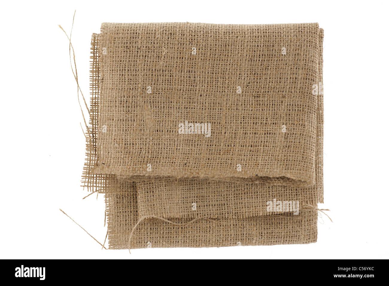 Folded coarse hessian material - Stock Image