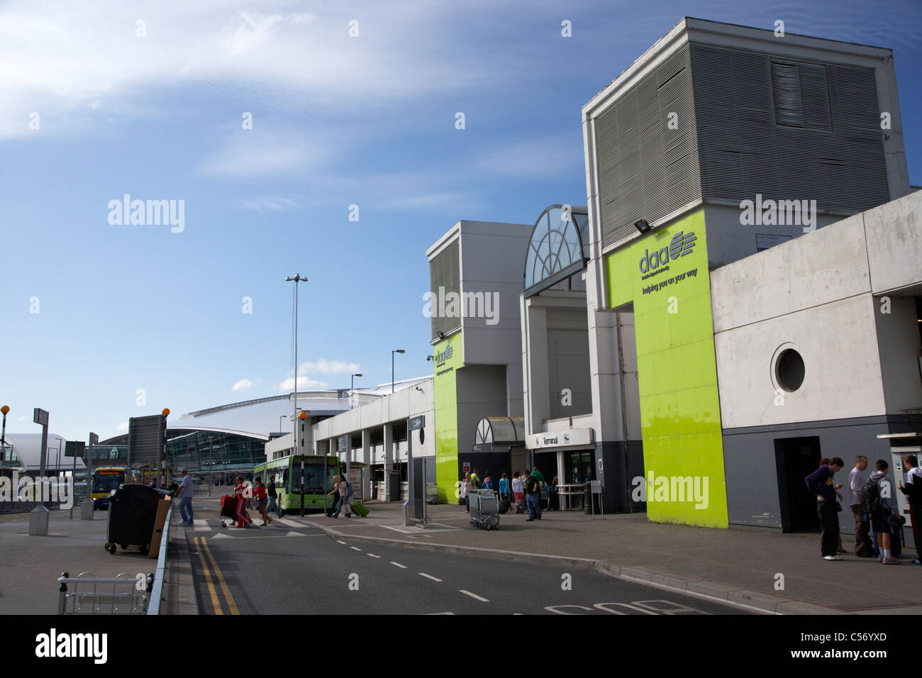 passengers crossing pedestrian crossing at old terminal 1 entrance dublin airport republic of ireland europe - Stock Image