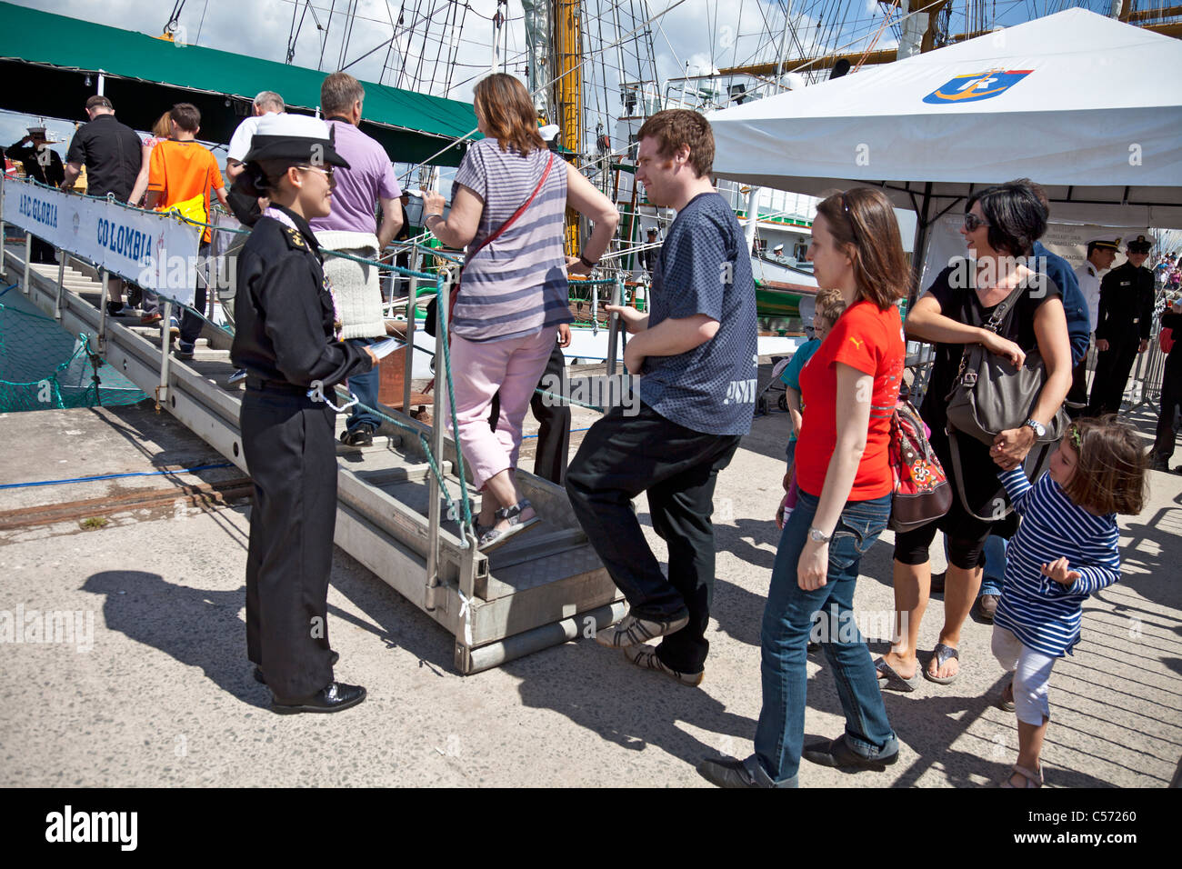 Crew of the Colombian Tall Ship ARC Gloria welcome the public on board at Greenock, Scotland. Tall Ships Race 2011. - Stock Image