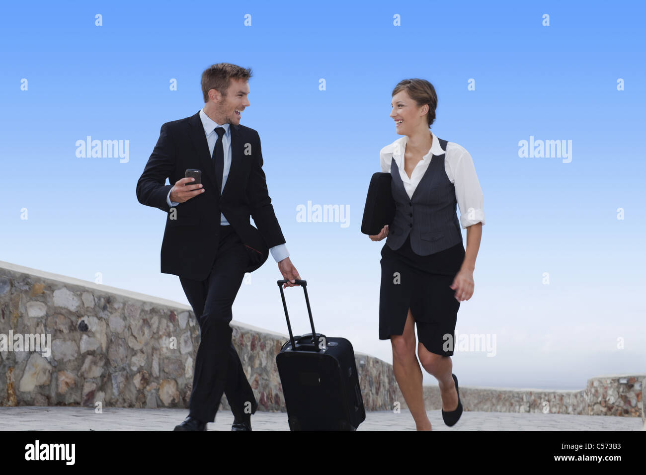 Business people running with luggage Stock Photo