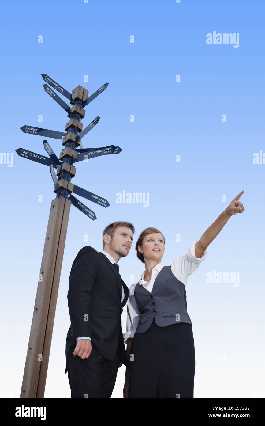 Business people at crossroads - Stock Image
