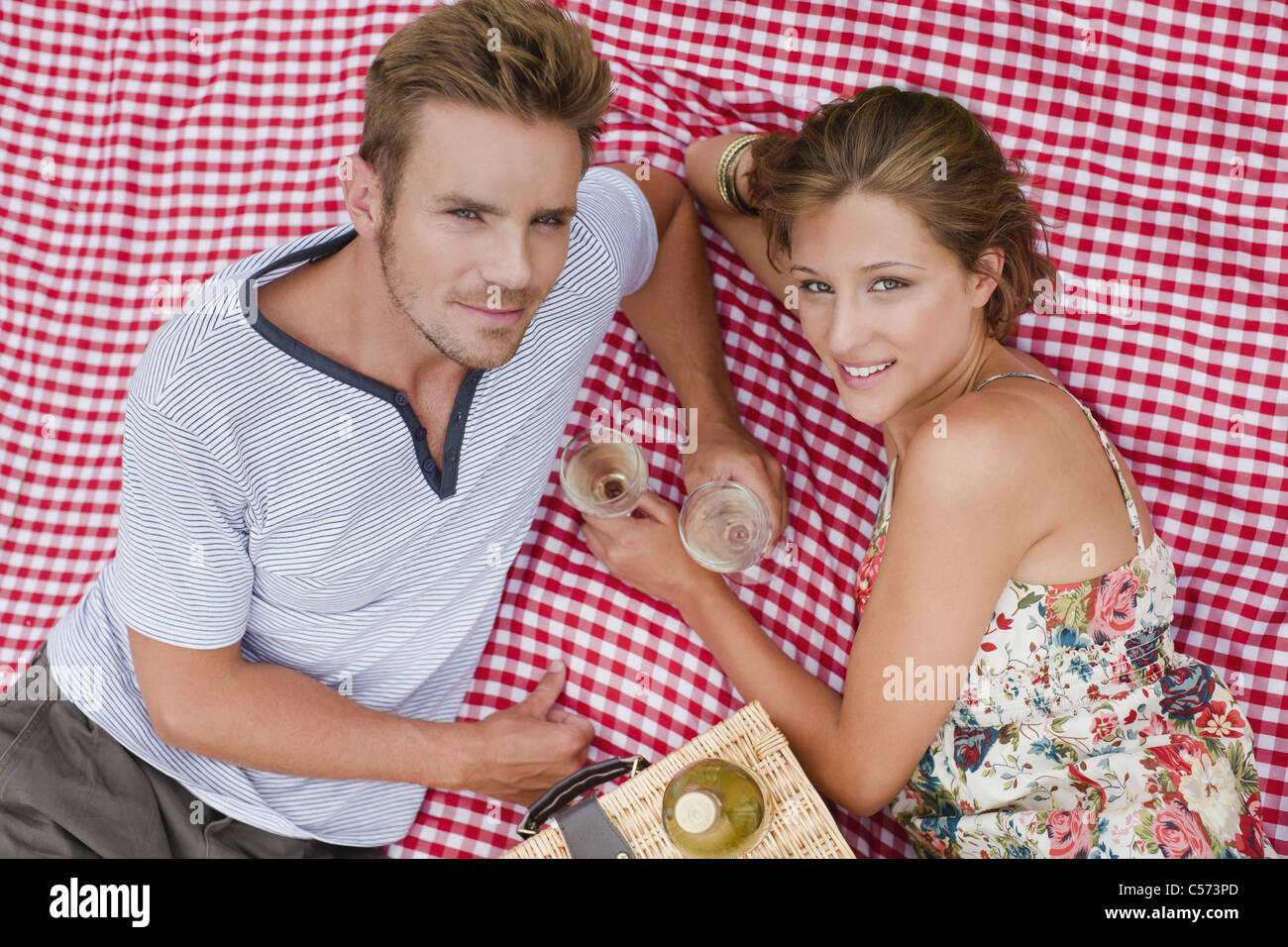 Couple picnicking together - Stock Image