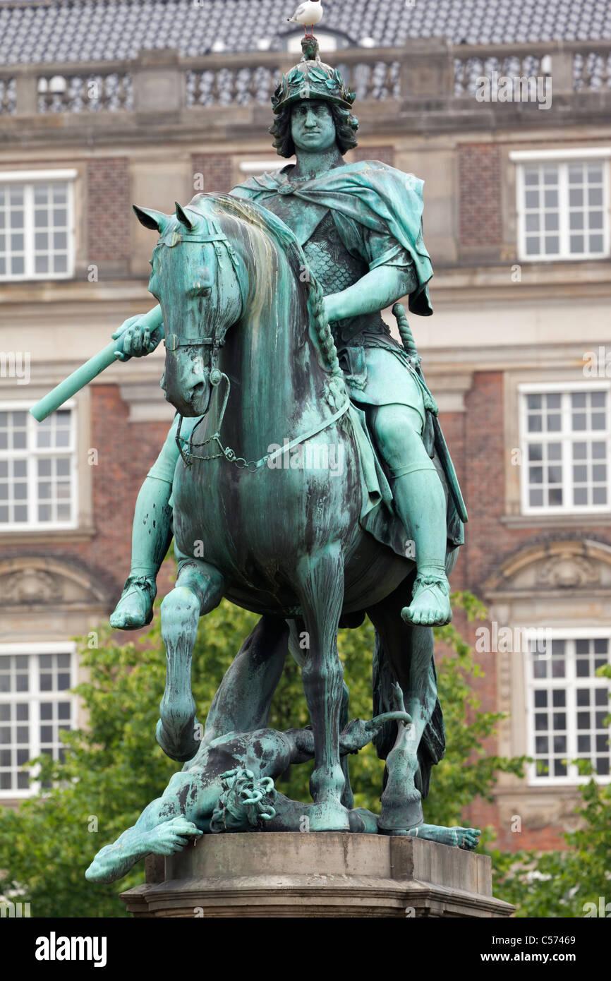 Pompous equestrian statue of Christian V in Kongens Nytorv, Copenhagen Denmark - Stock Image