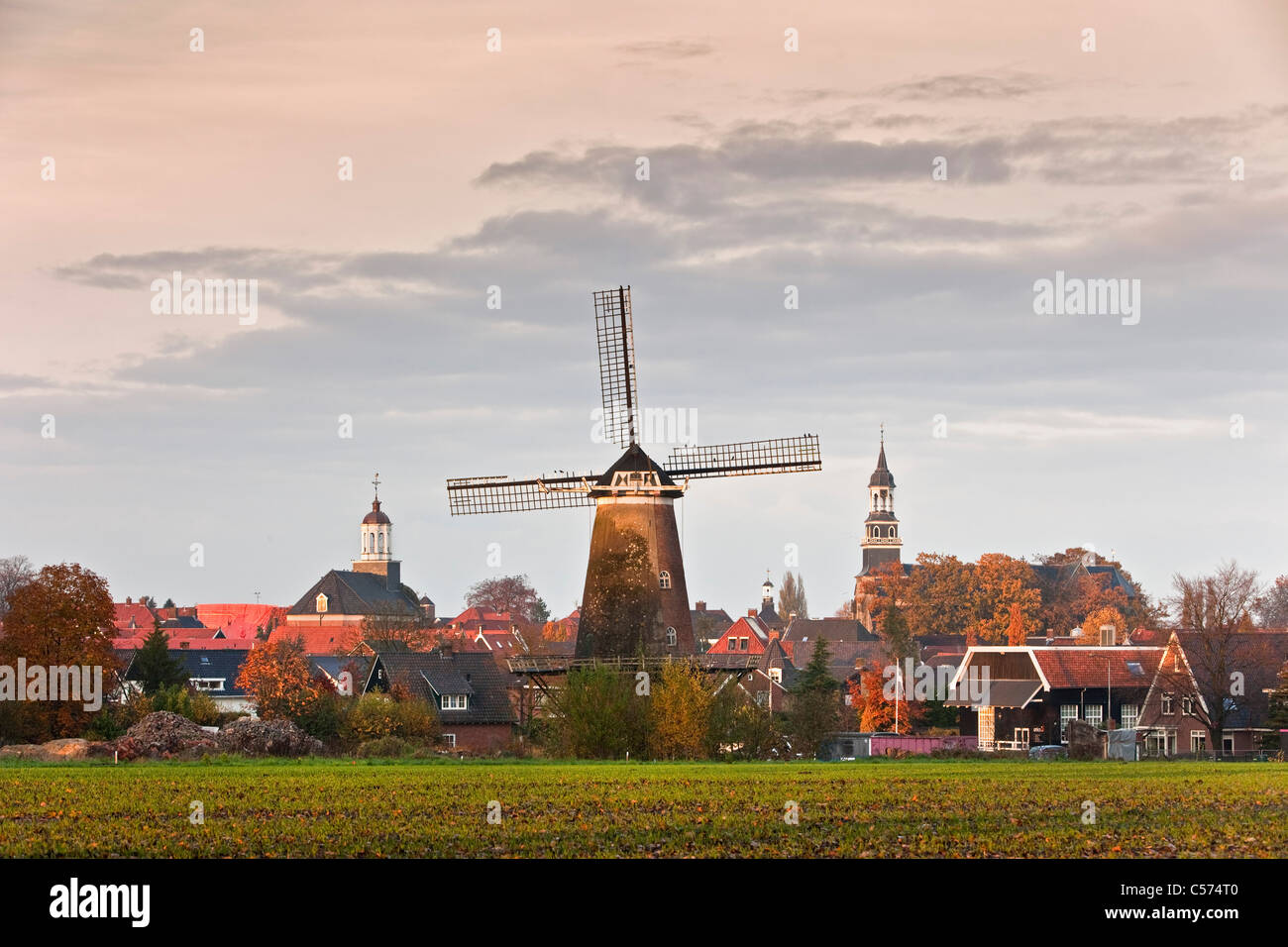 The Netherlands, Ootmarsum. View on village with windmill and churches. Autumn. - Stock Image