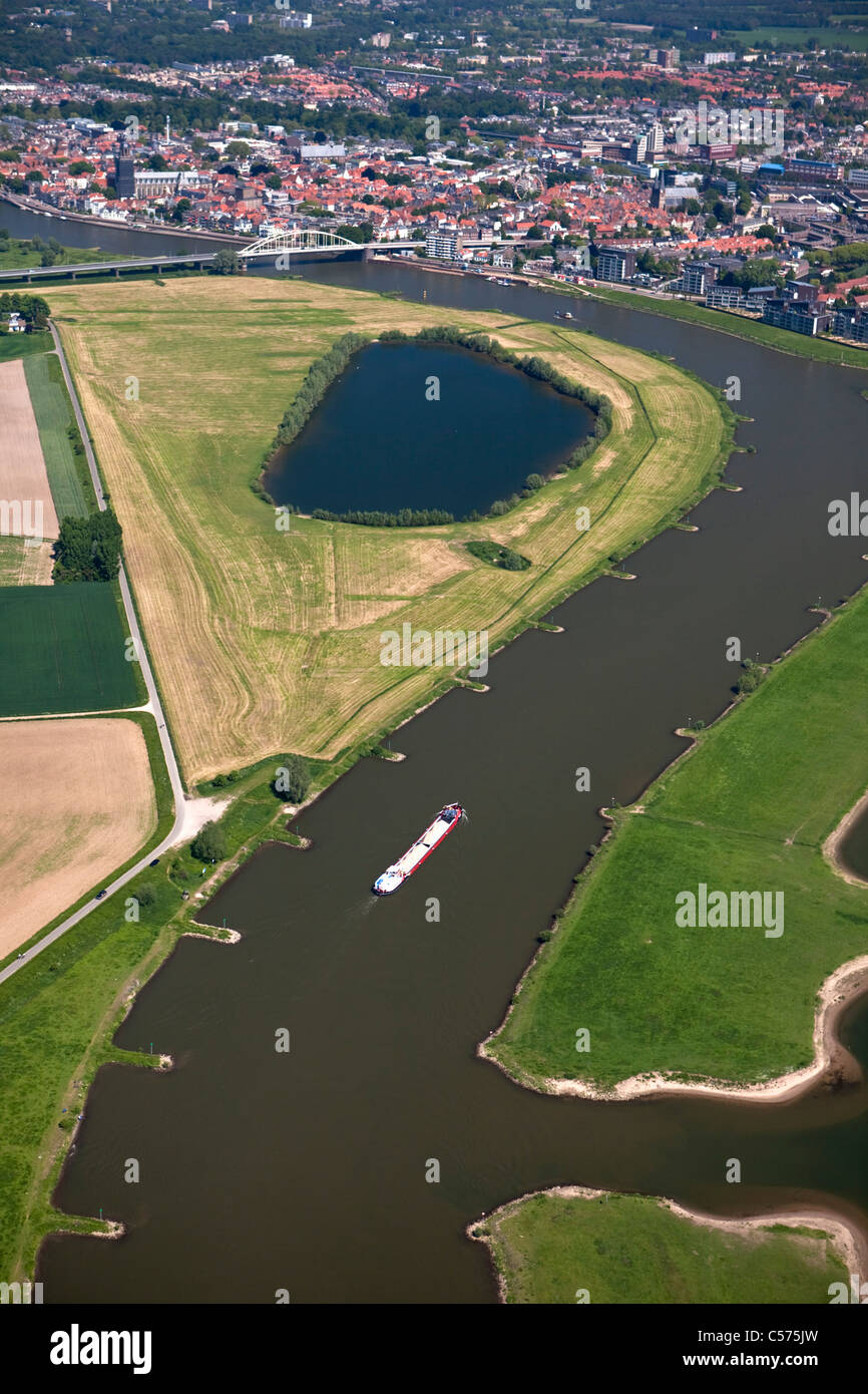 The Netherlands, Deventer, Cargo boat in IJssel River. Aerial. - Stock Image