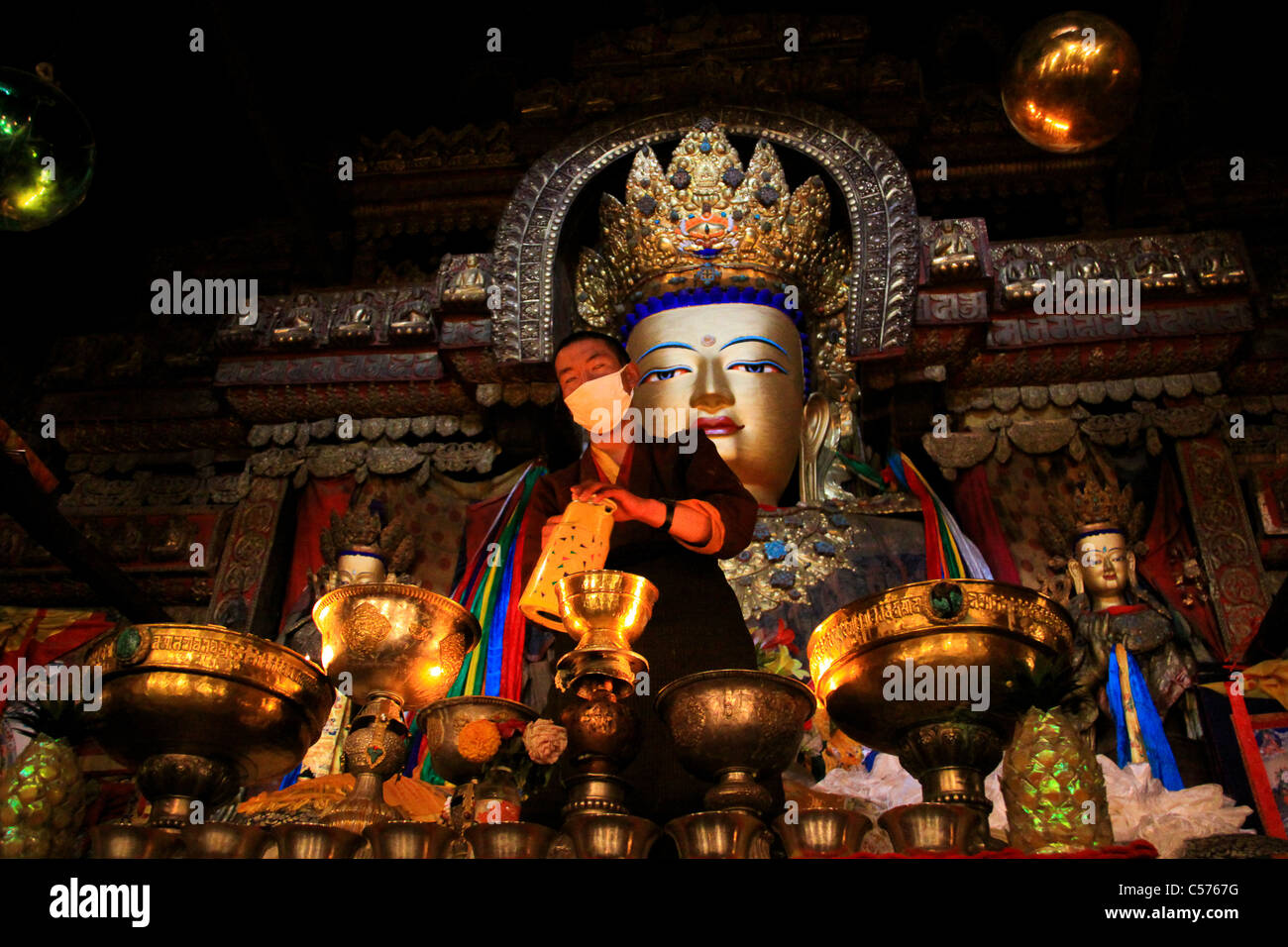 Buddha and Buddhist Monks Praying, Gyantse, Tibet, China China - Stock Image