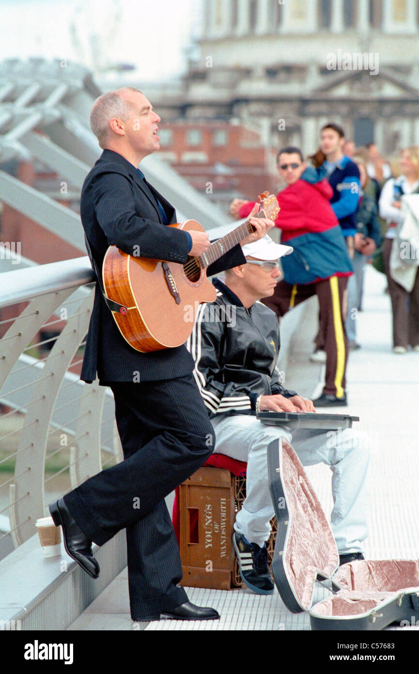 The Pet Shop Boys busking (still from music video directed by Martin Parr) - Stock Image