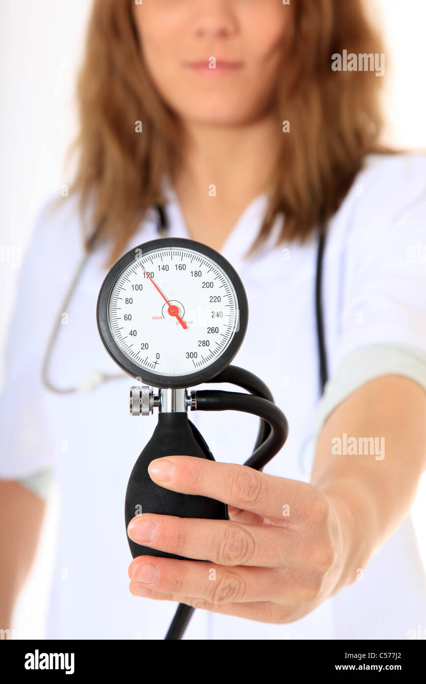 Doctor holding blodd pressure meter. All on white background. Stock Photo