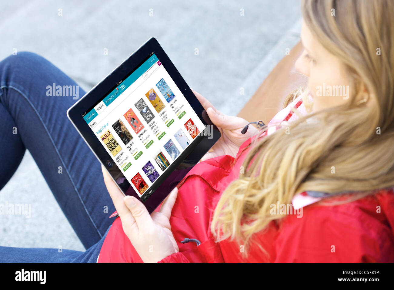 Close up view of woman's browsing Kobo online book store app on an