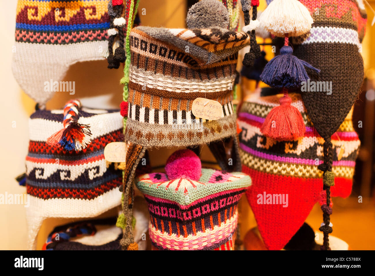 Colorful Chullos or hats made from Alpaca wool for sale as souvenirs in a  store on 82991a3efef1