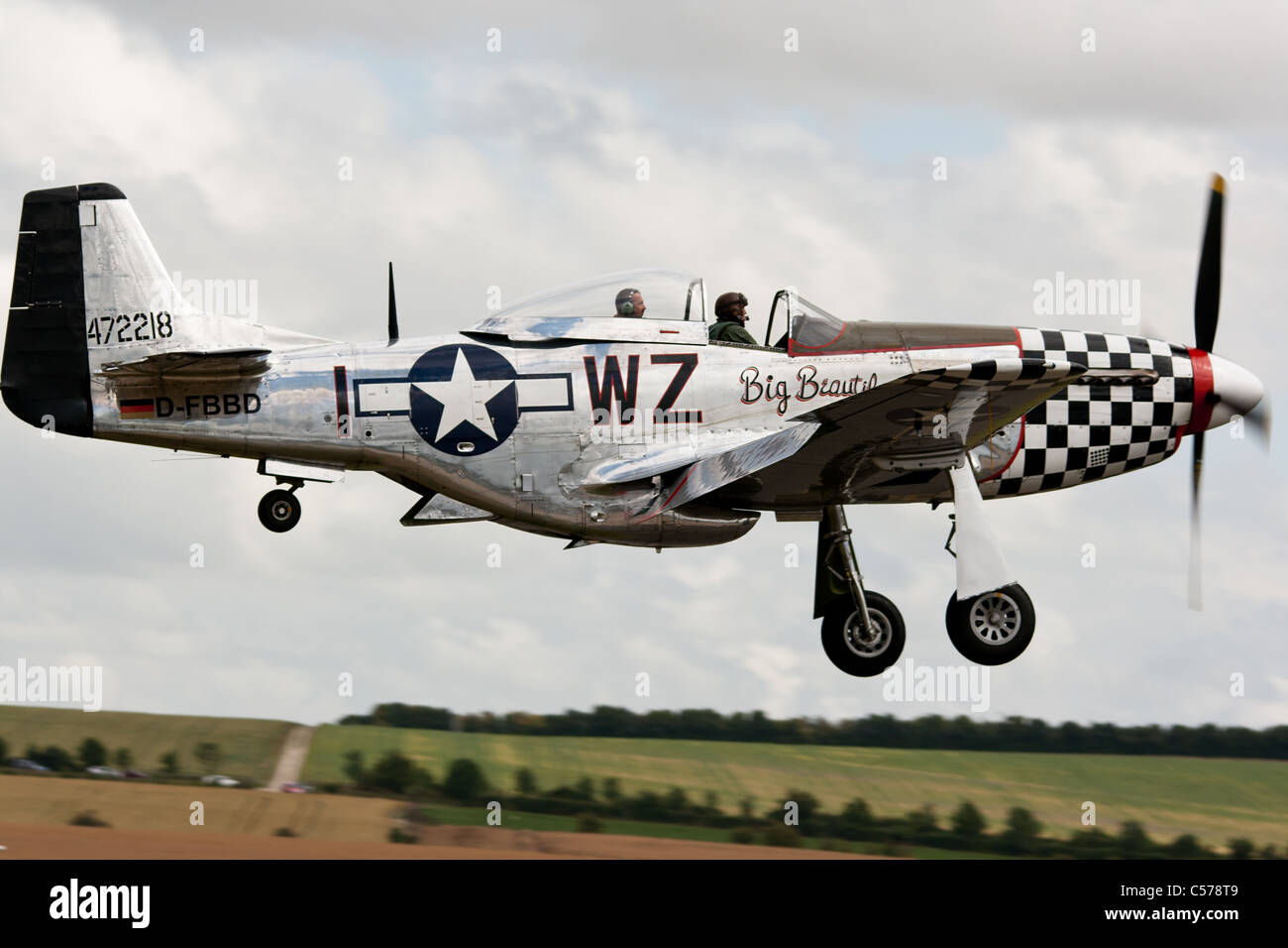 North American P-51D Mustang 'Big Beautiful Doll' about to land at the IWM Duxford two days before she was - Stock Image