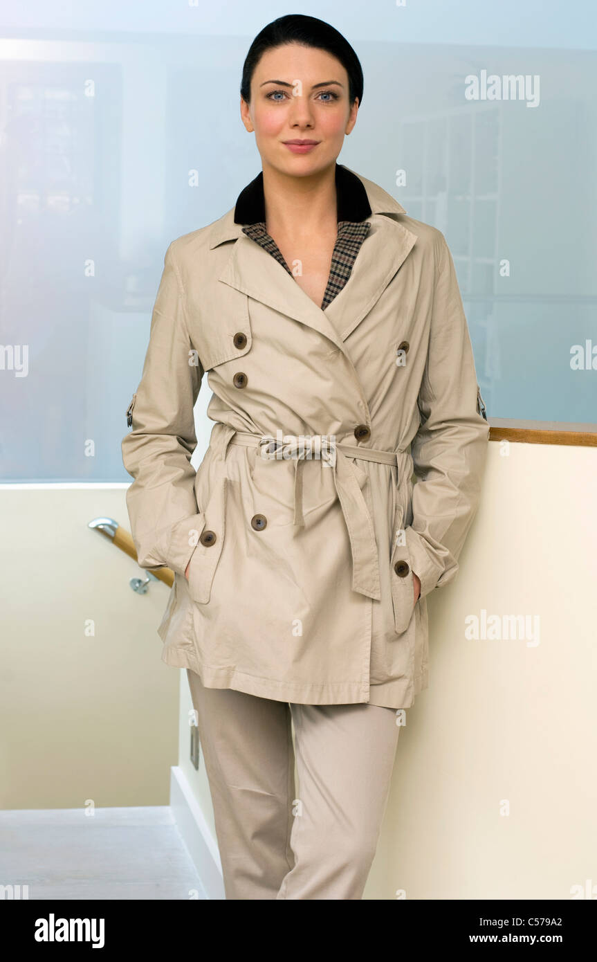 Woman wearing trench coat - Stock Image
