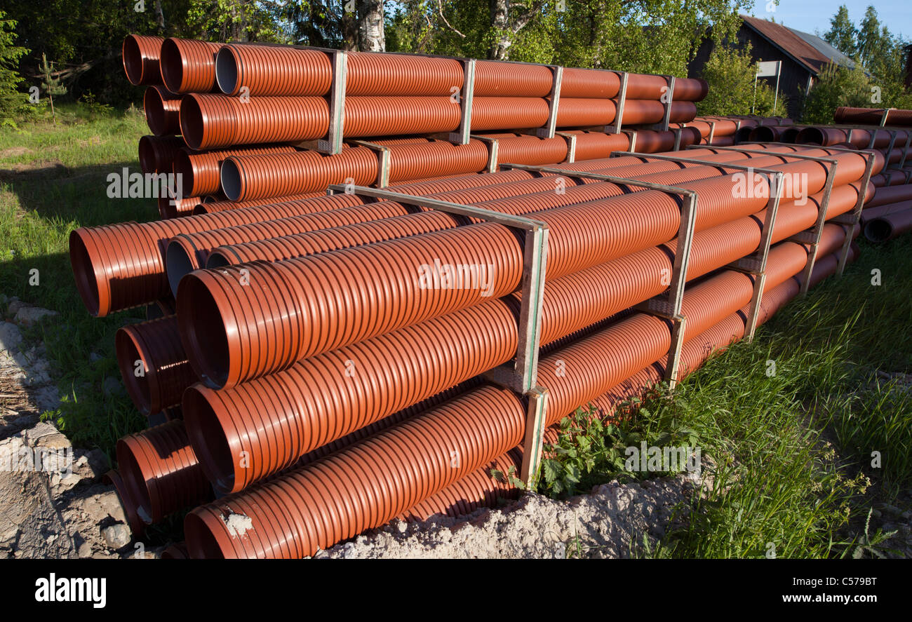 Pile of PVC drainage / sewer pipes waiting for assembly , Finland Stock Photo