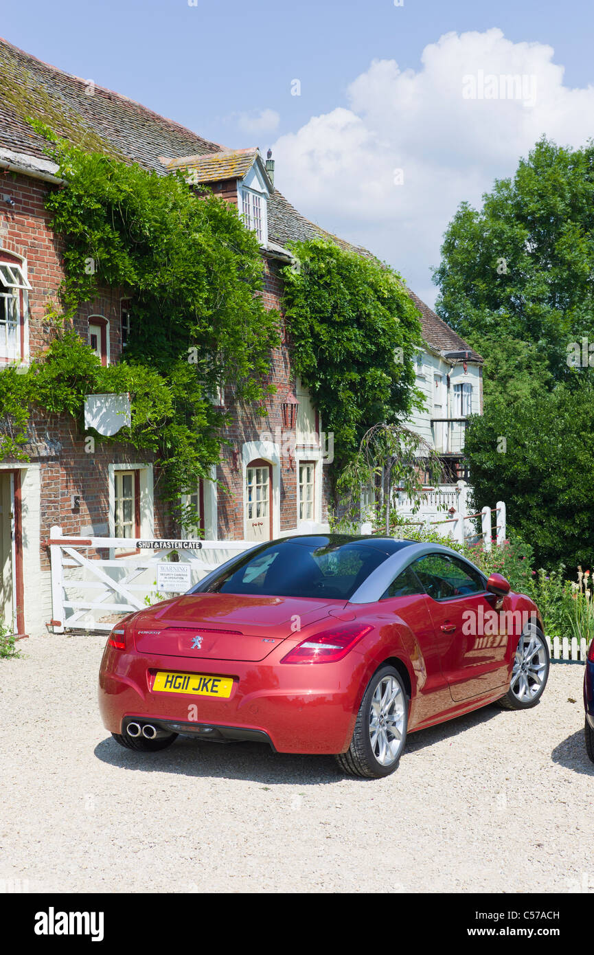 New Peugeot CRZ sports coupe car parked outside Corfe Mullen mill in Dorset - Stock Image
