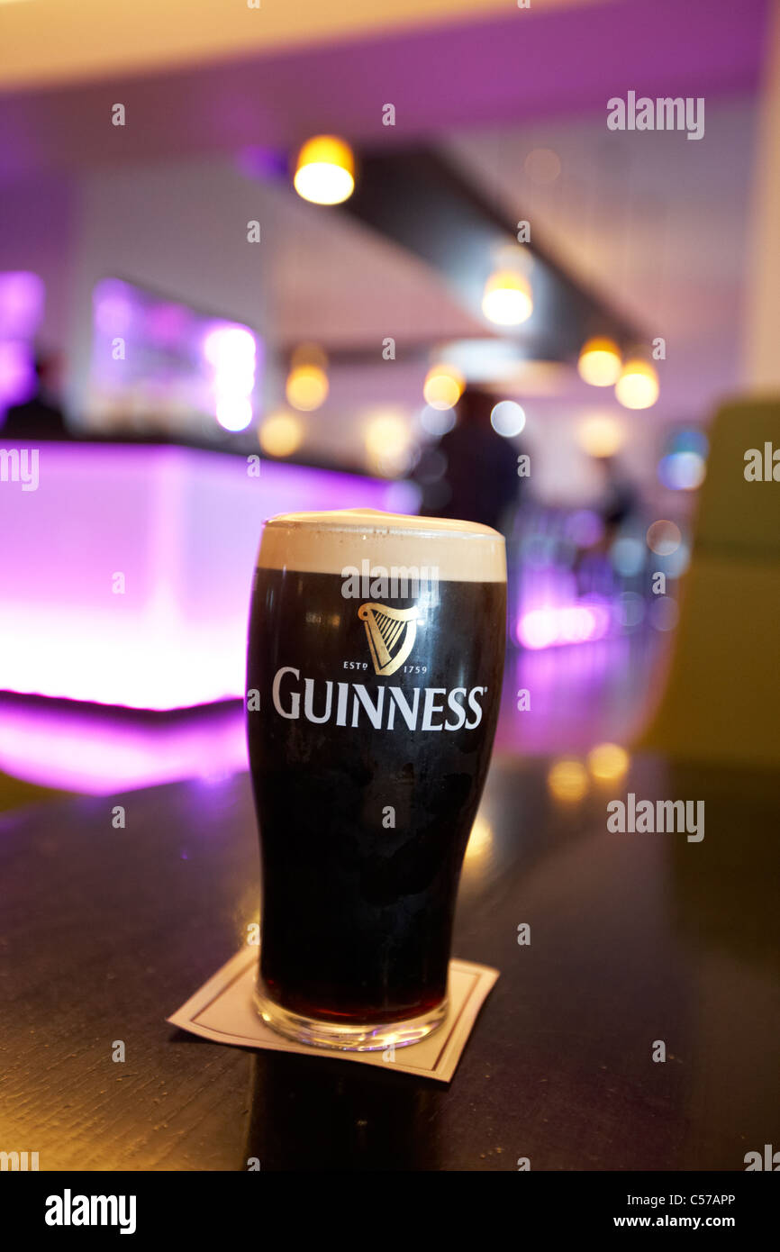 pint of guinness poured in a dublin pub bistro restaurant republic of ireland - Stock Image