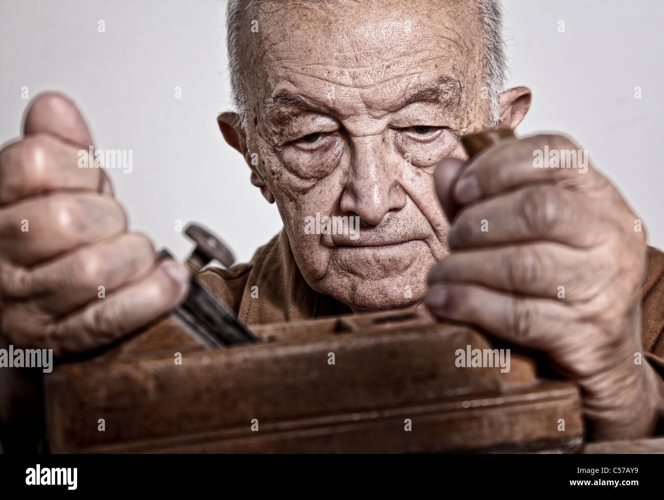 close up image of old carpenter on duty - Stock Image