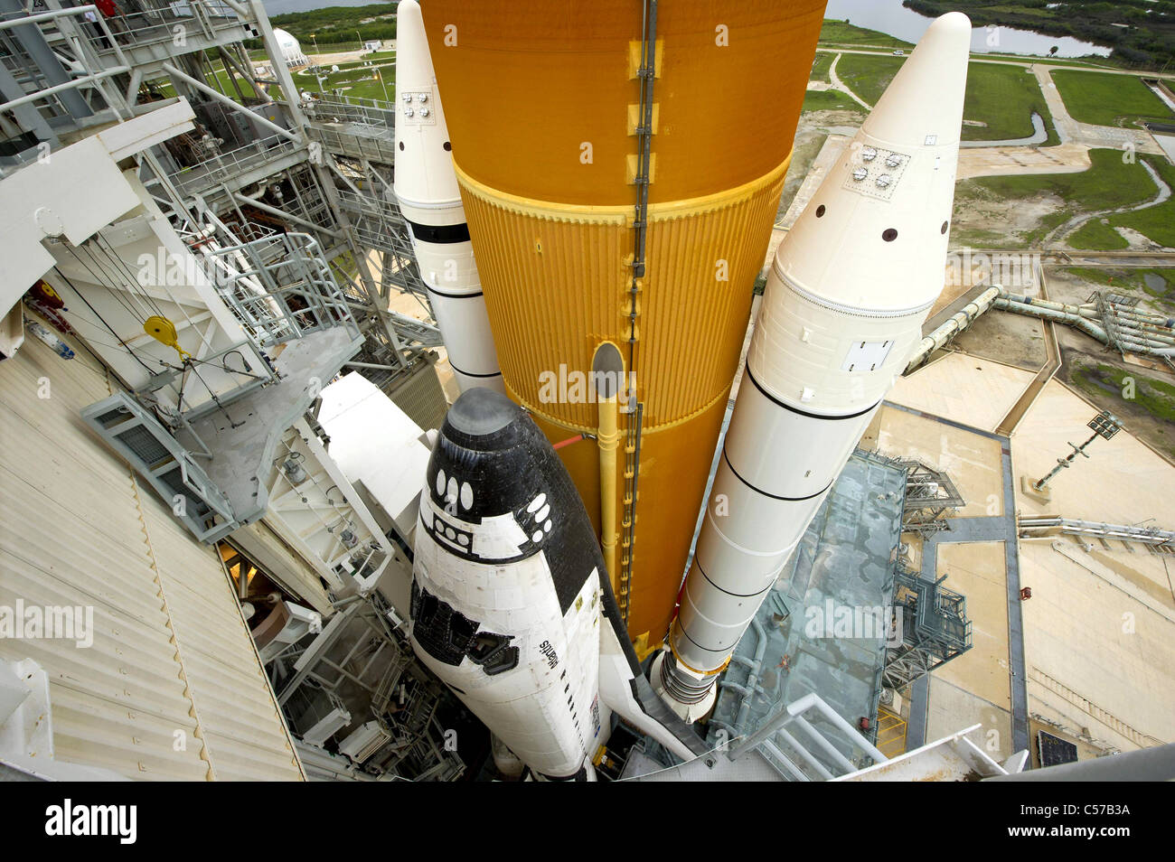 Space shuttle Atlantis revealed as the rotating service structure is rolled back at Launch Pad 39A  before it's - Stock Image
