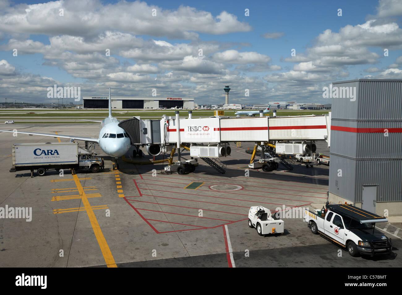 air canada aircraft and airport vehicles Toronto Pearson International Airport Ontario Canada - Stock Image