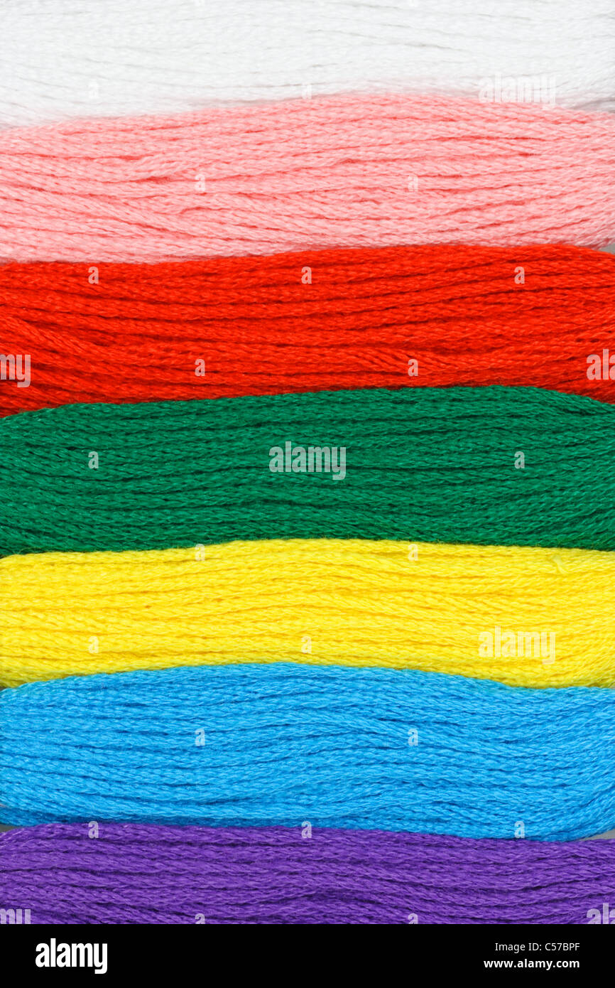 Close up of multicolor embroidery threads background - Stock Image