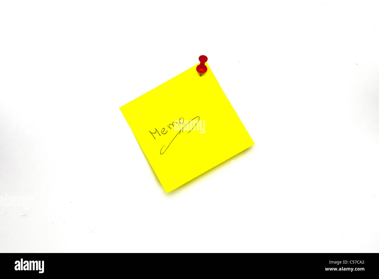 a yellow notepad with a red pin needle - Stock Image