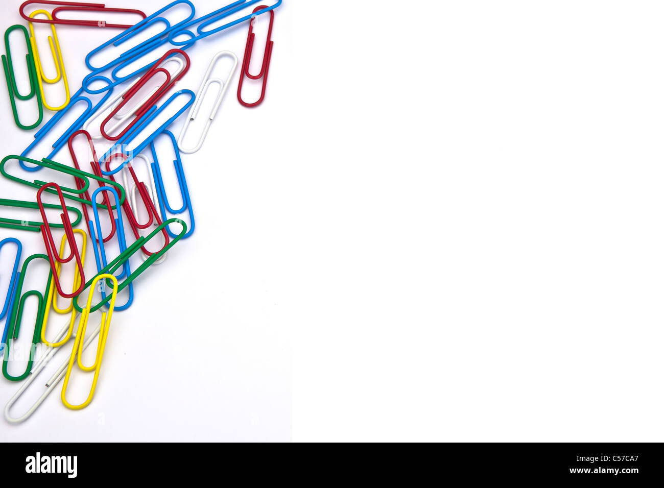 several paper clips as a frame on a white background - Stock Image