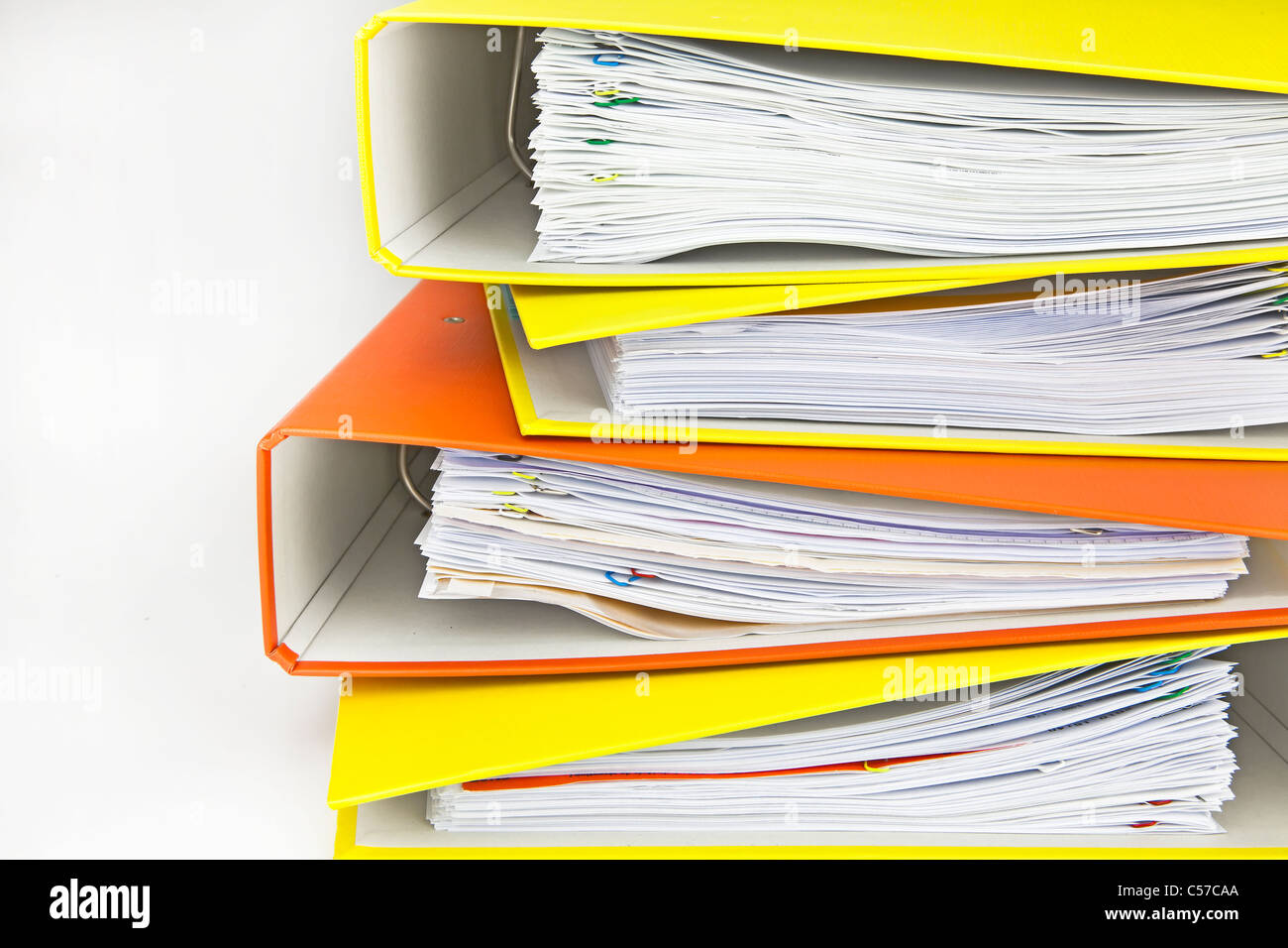 yellow and orange file folders stacked on each other - Stock Image