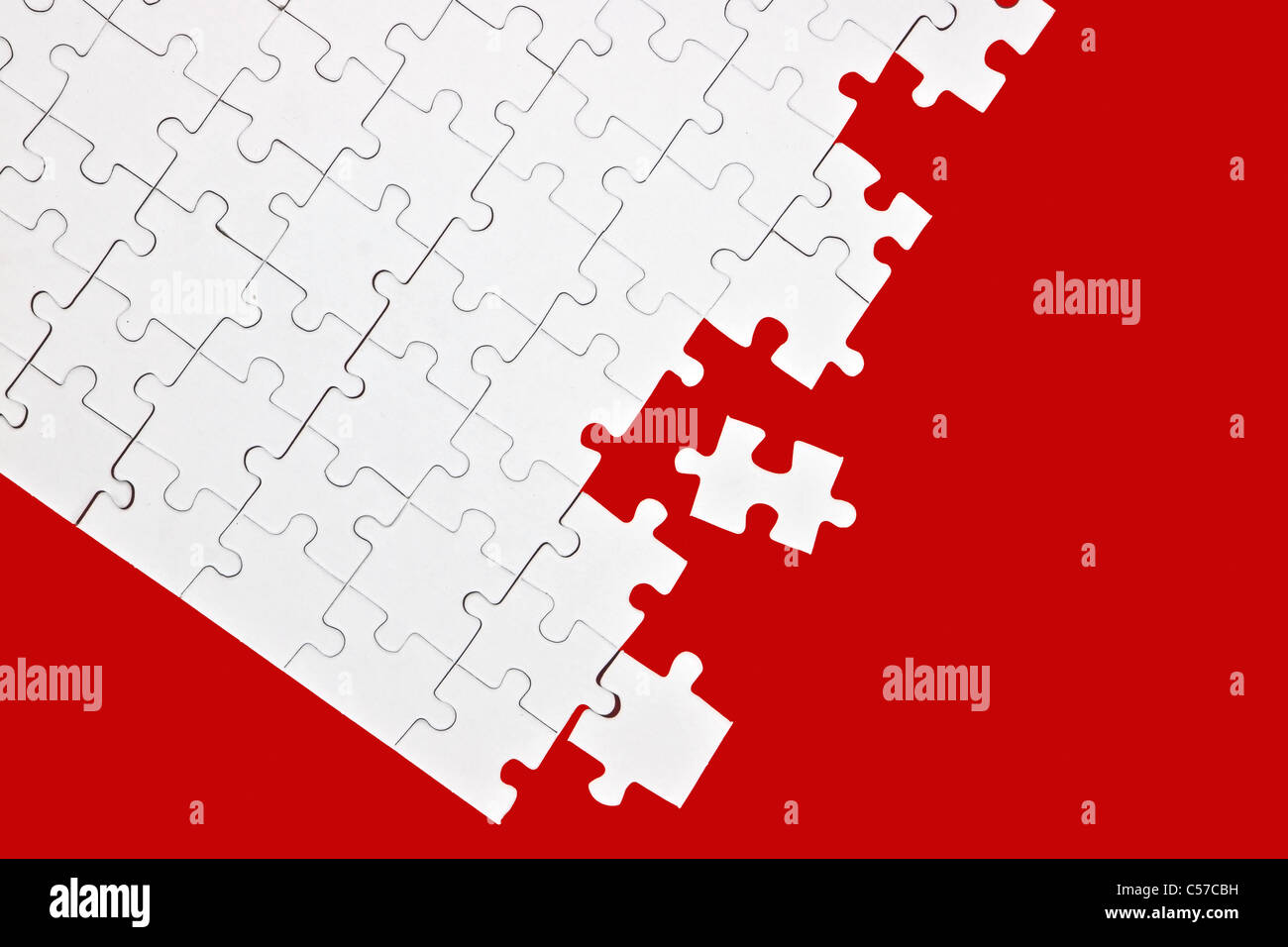 a puzzle with missing parts, which are connected - Stock Image