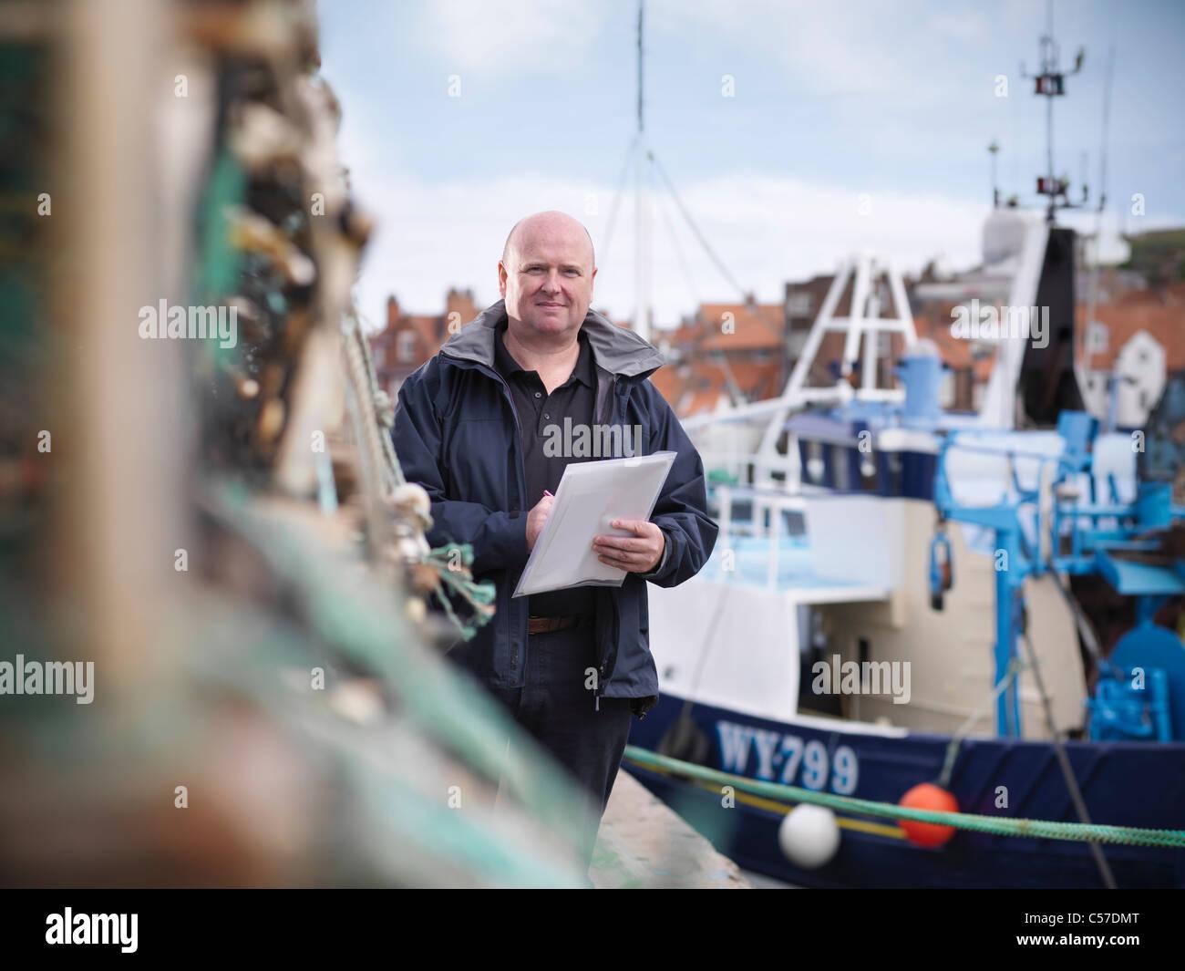 Fish inspector on fishing boat - Stock Image