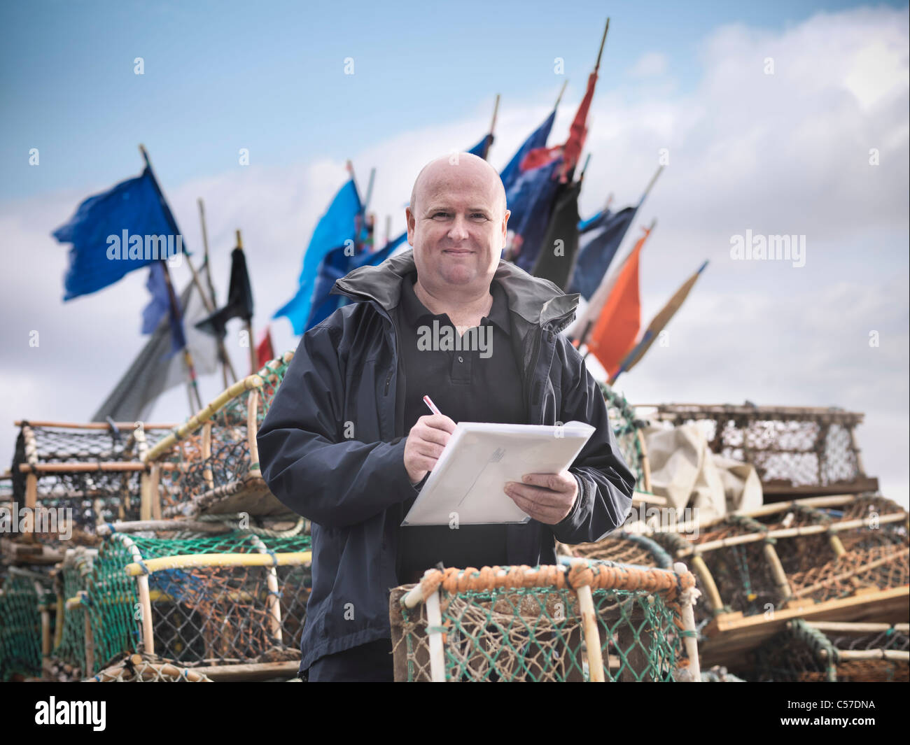 Fish inspector with lobster pots - Stock Image