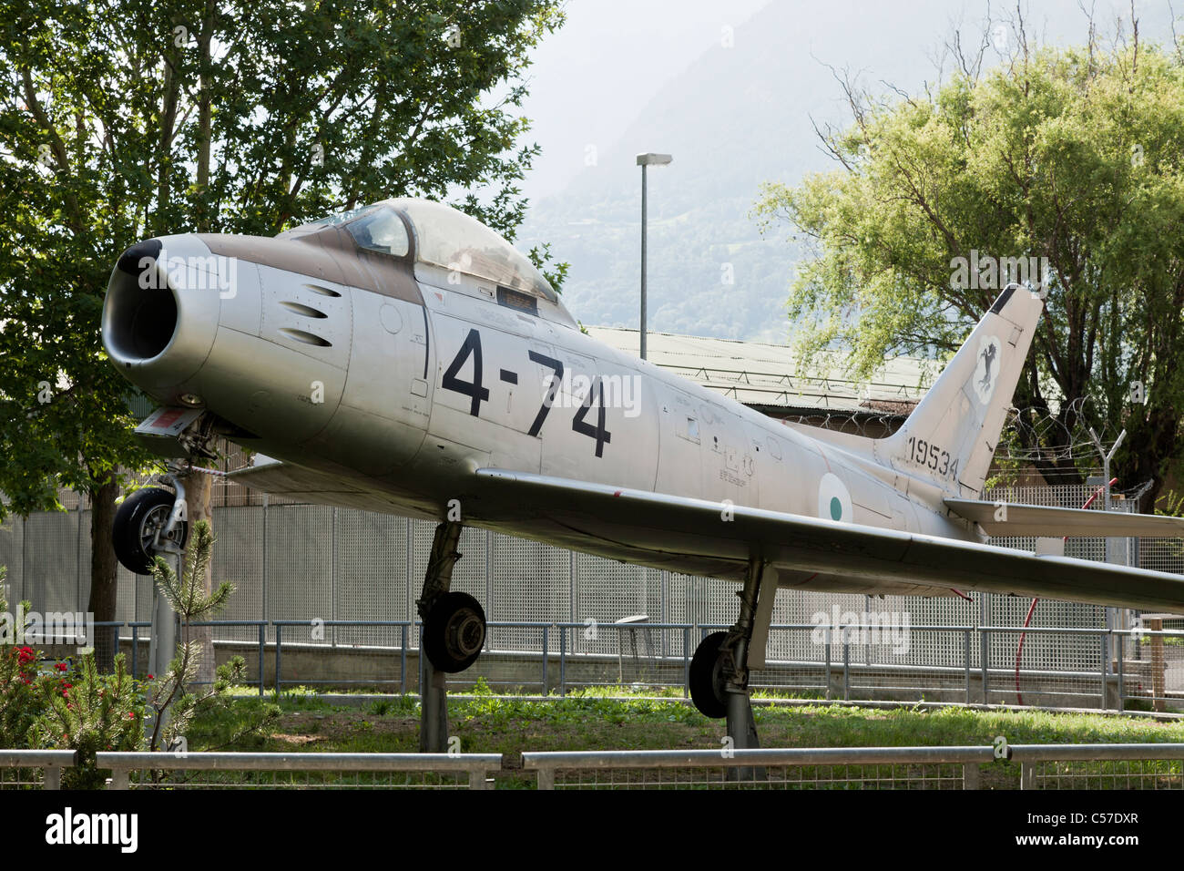 Canadair F-86 Sabre 4 belonging to the Italian Air Force, preserved at Aosta Airport, Italy - Stock Image