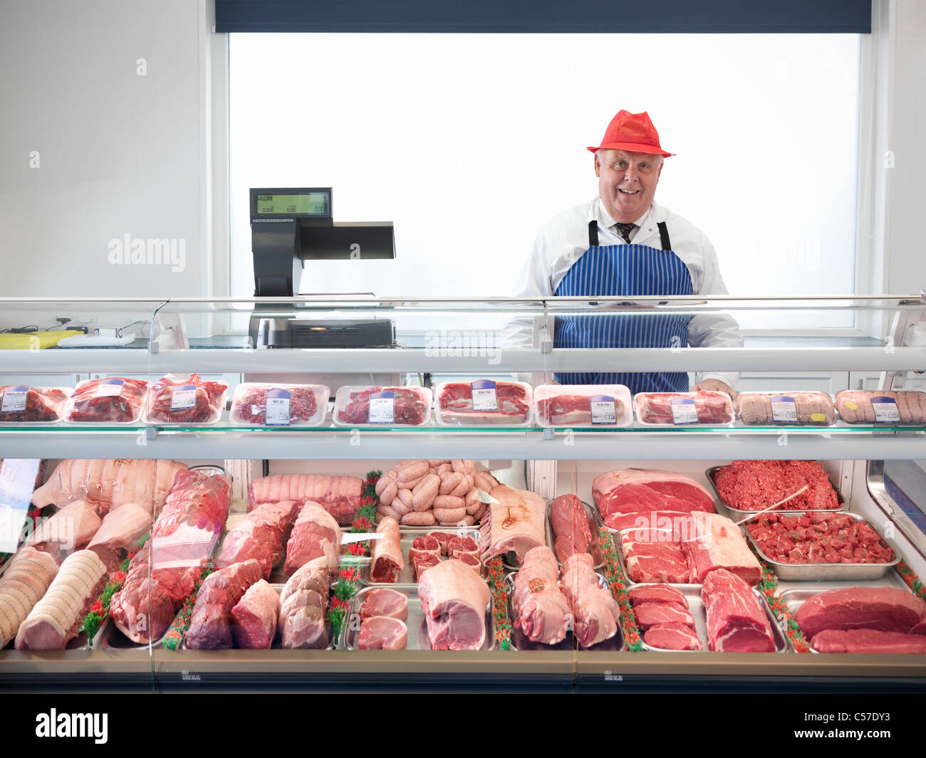 Butcher Standing Behind Meat Counter Stock Photo 37658631