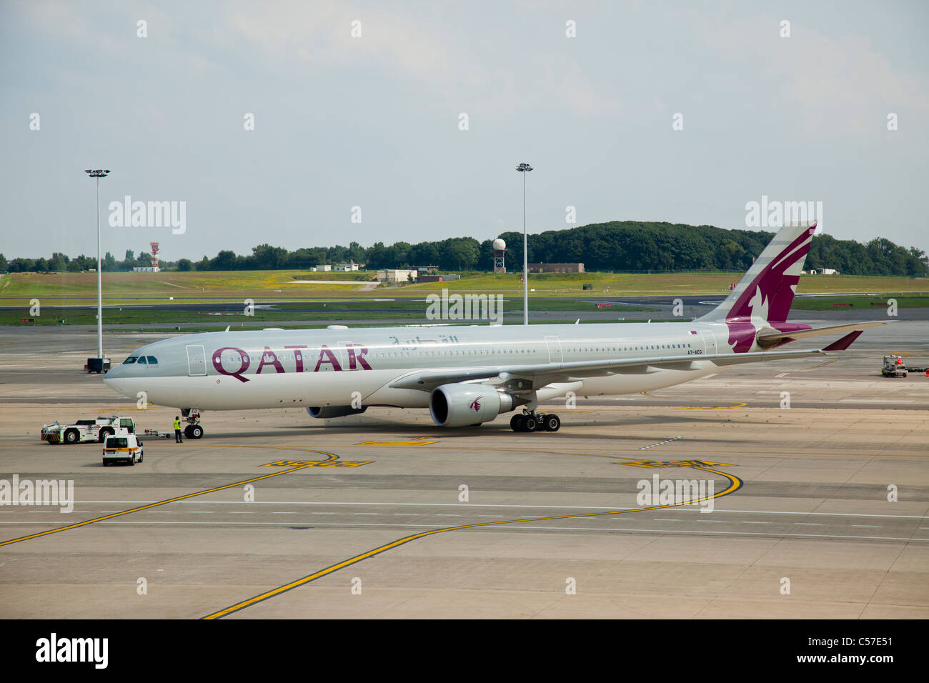 Airbus A330-302, reg A7-AEG, belonging to Qatar Airways, at Brussels International Airport - Stock Image