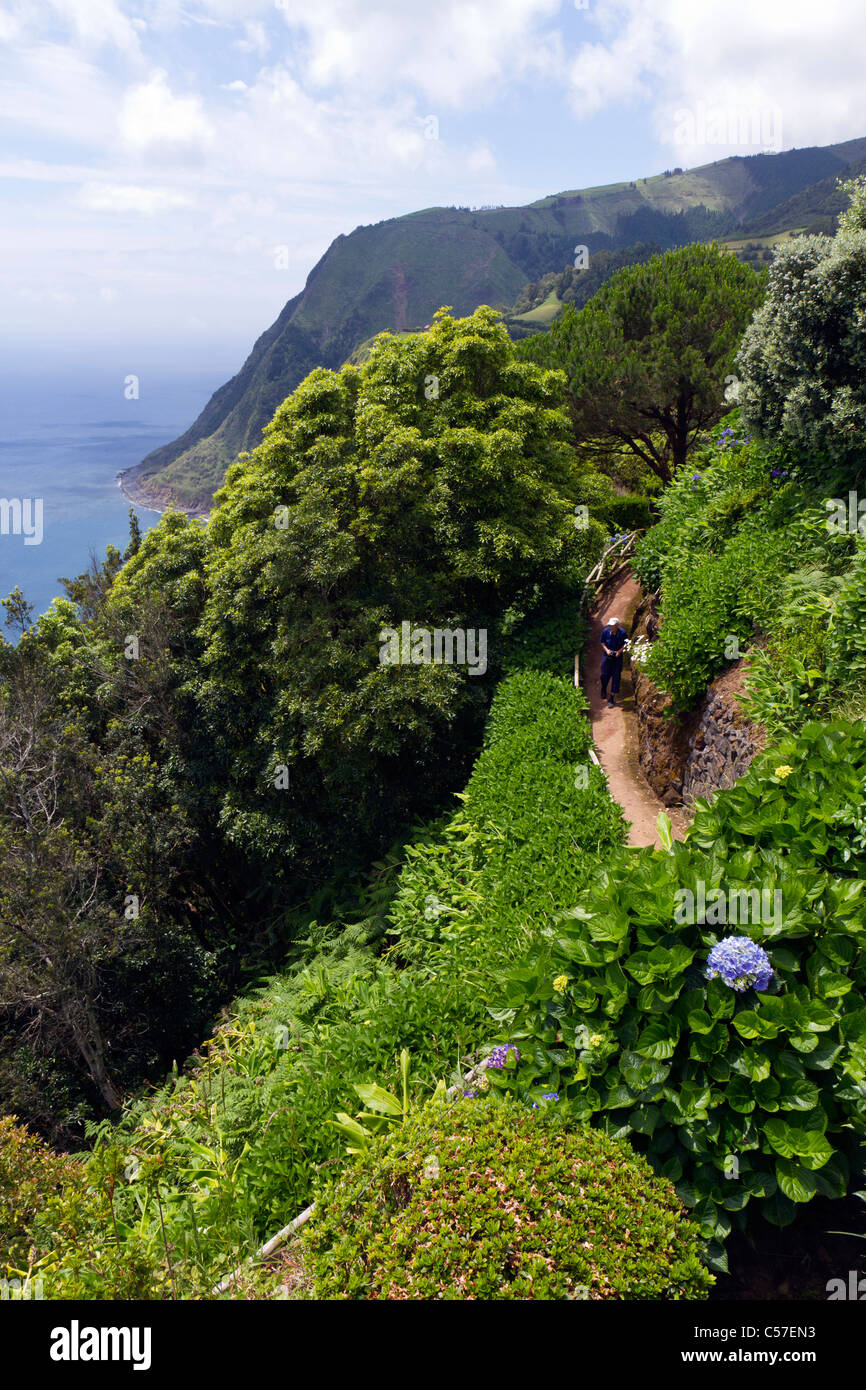 Man in the park at the Sossego viewpoint, São Miguel island, Azores, Portugal - Stock Image