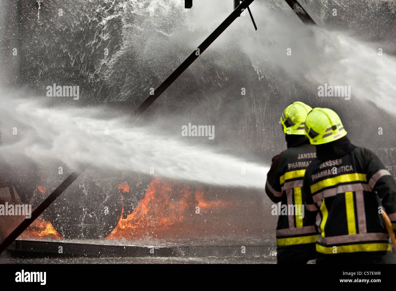 The Netherlands, Rotterdam, Multidisciplinary training center of Falck emergency. Fireman learning to extinguish - Stock Image