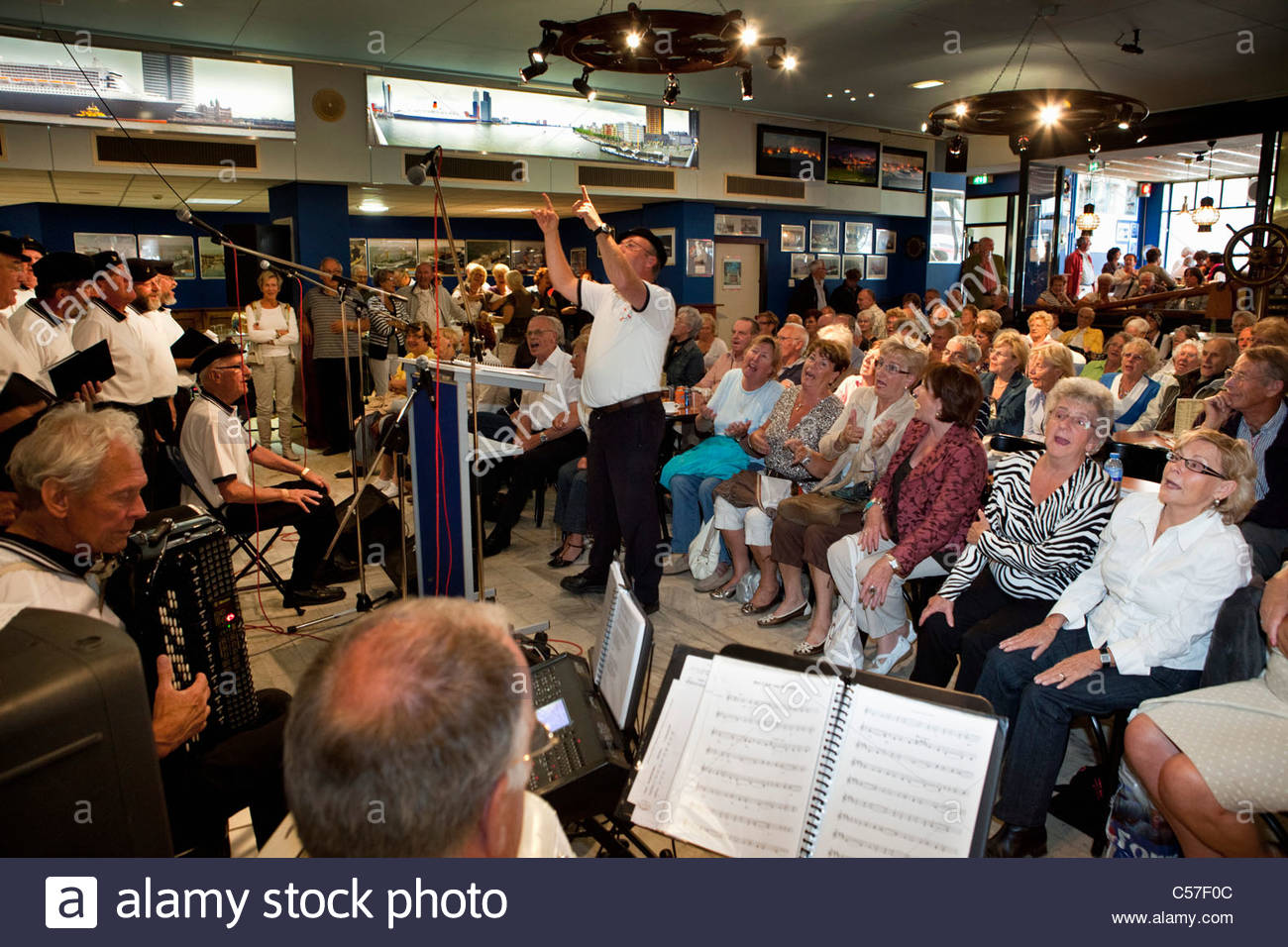 The Netherlands, Rotterdam, Choir performing seaman songs. - Stock Image