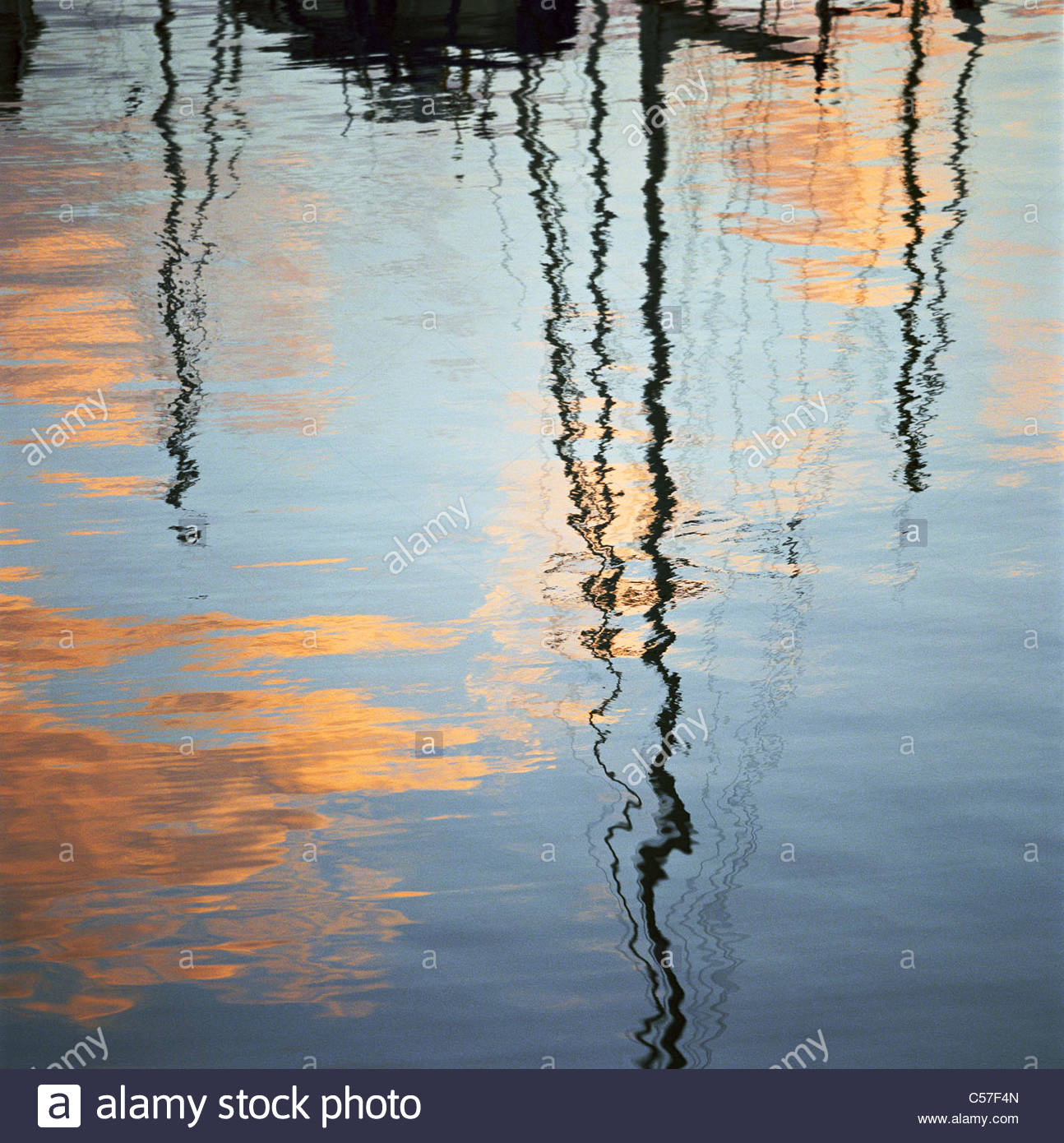 Sailboats reflected in water - Stock Image