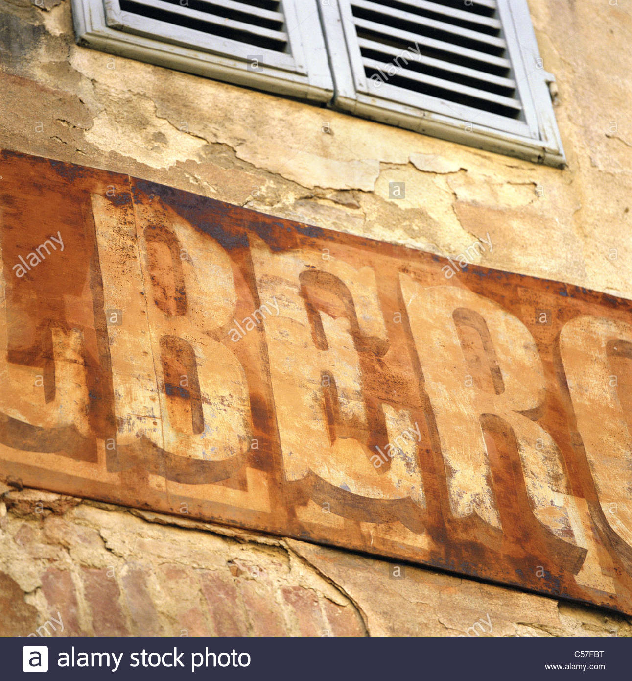 Close up of weathered sign on building - Stock Image