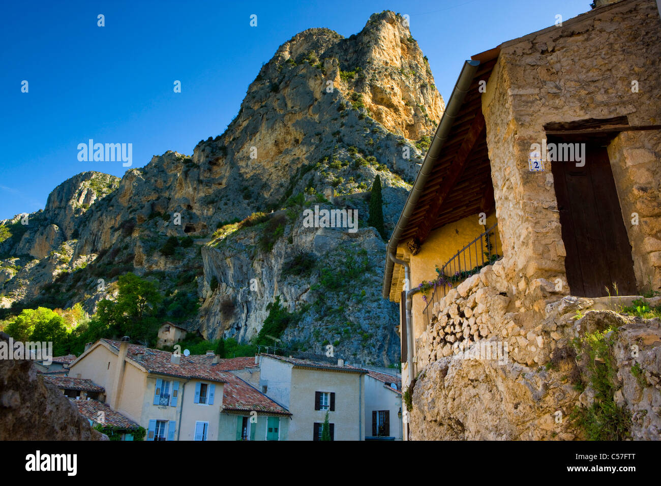 Moustiers-Sainte-Marie, France, Europe, Provence, Alpes-de-Haute-Provence, village, houses, homes, mountains, rocks, Stock Photo