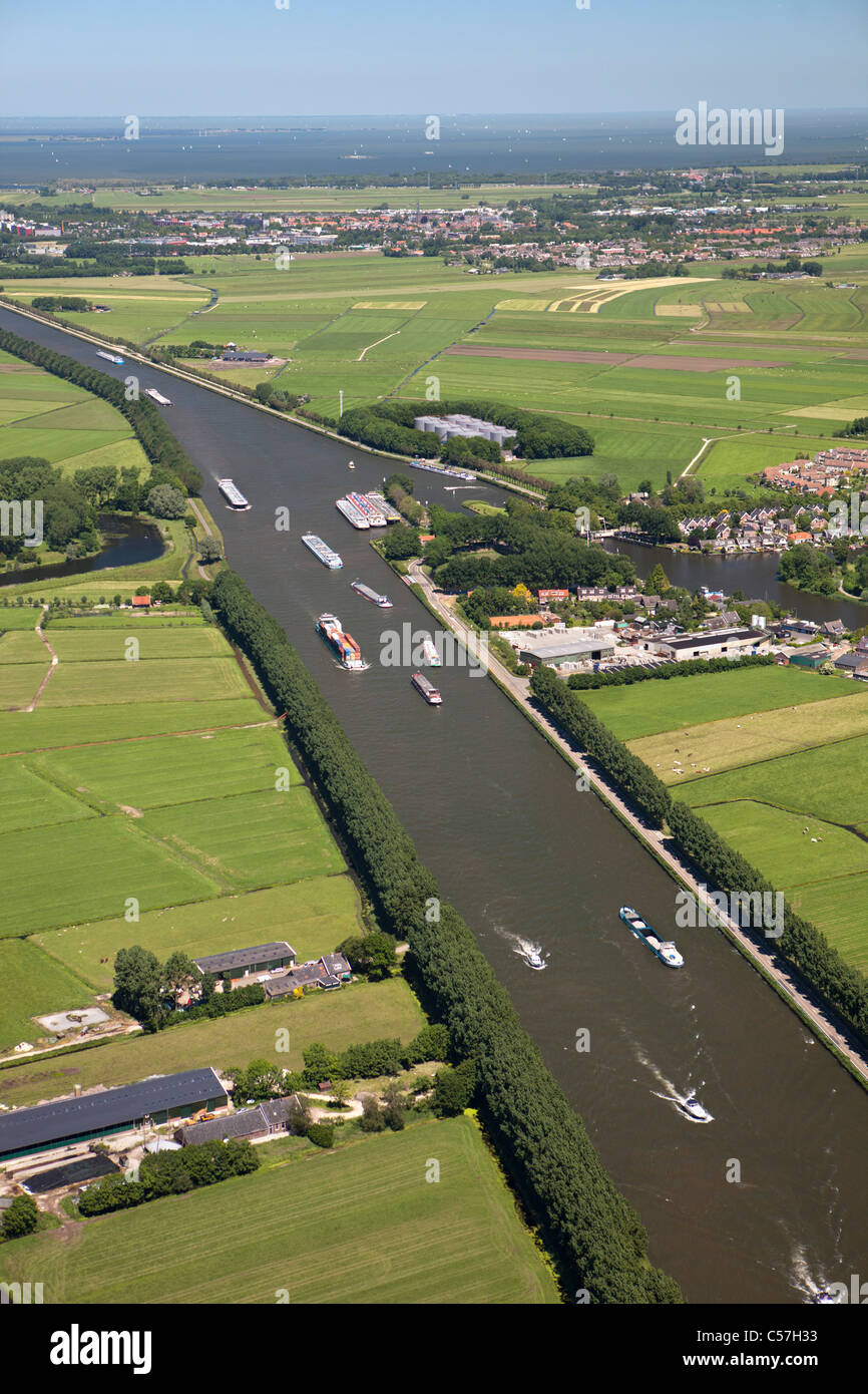 The Netherlands, Nigtevecht, Cargo ships on canal called Amsterdam Rijn Kanaal. Aerial. - Stock Image