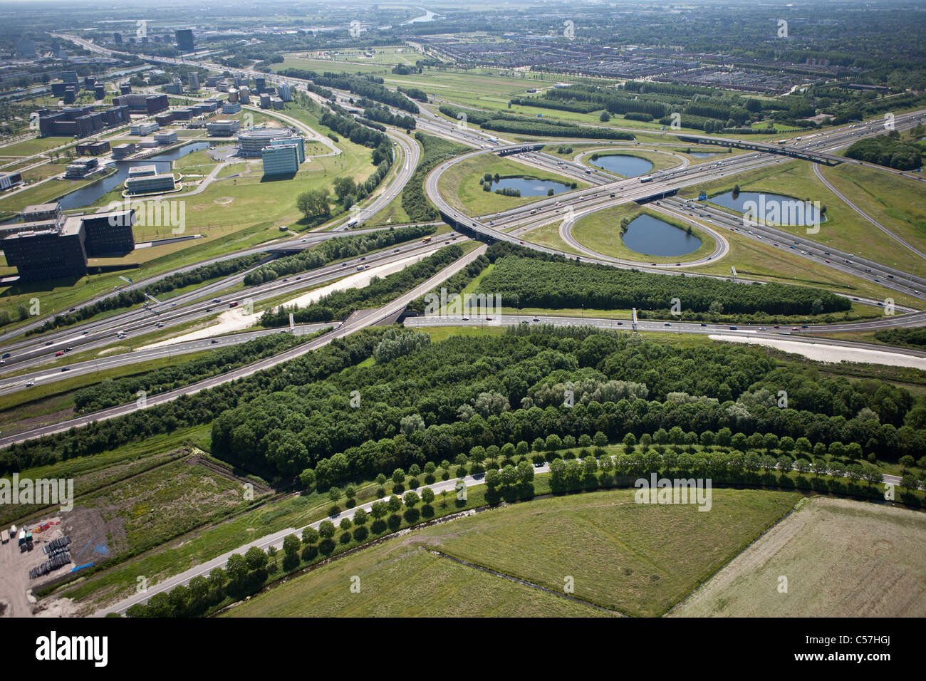 The Netherlands, Utrecht, Cloverleaf at Oudenrijn. Highway called A2 and A12. Aerial. - Stock Image