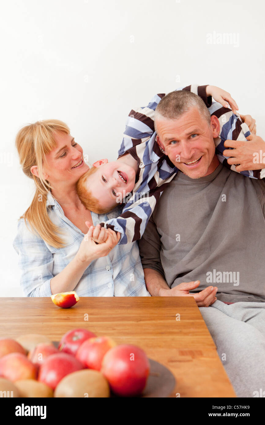 Family playing at table together - Stock Image
